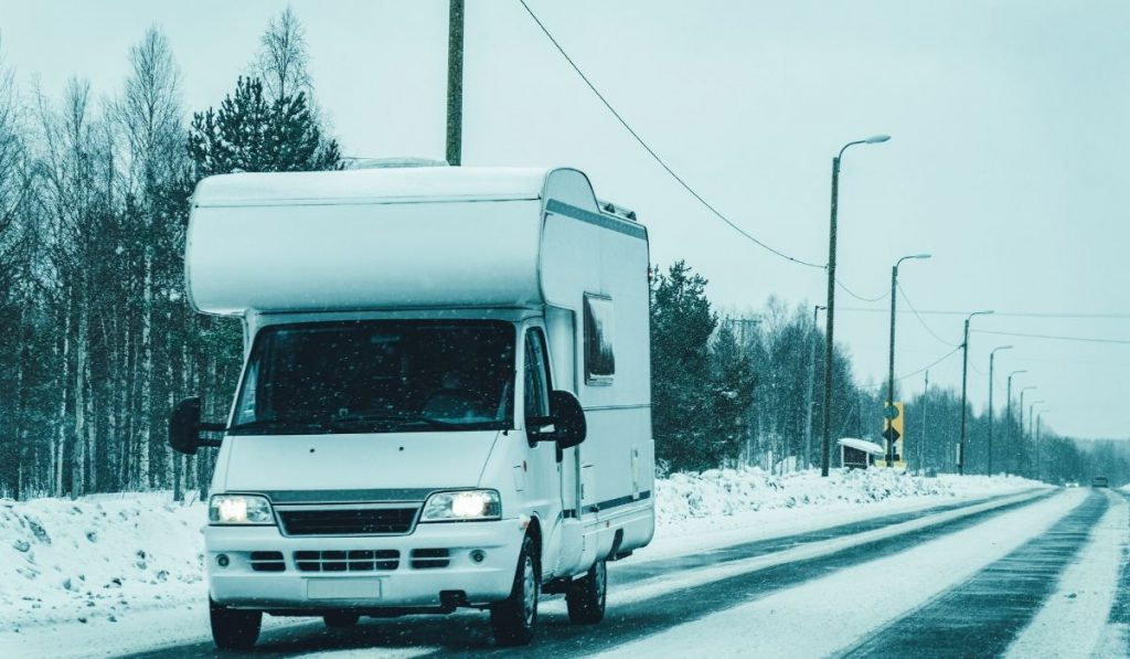 RV on the road with snow