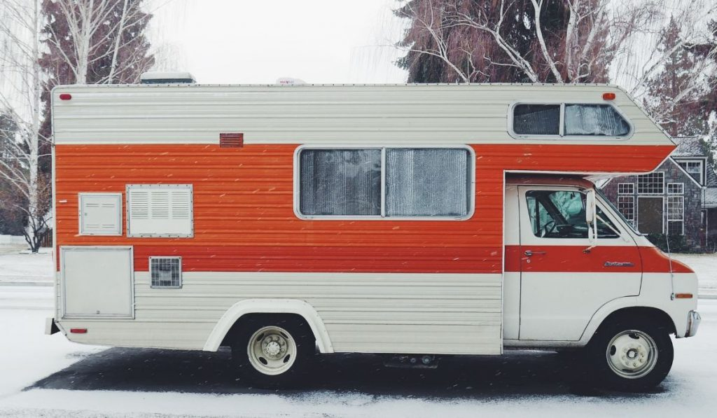 white and orange RV