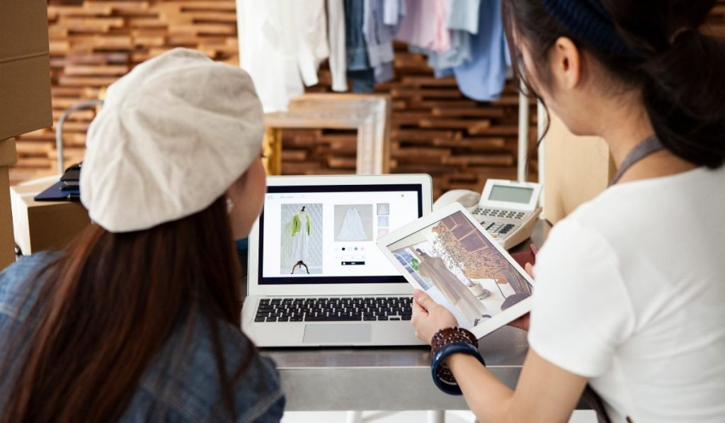 2 girls discussing about their online clothing store