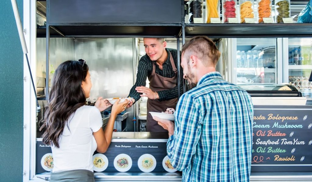 couples order and eat at the food truck