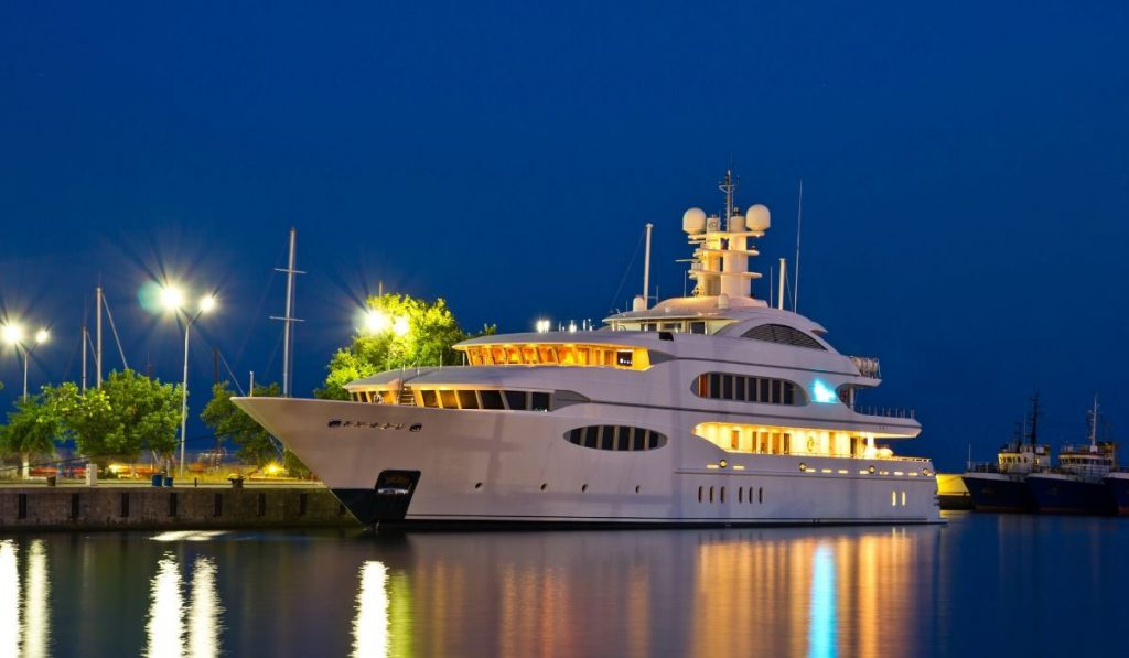 well lit yacht parked at the port