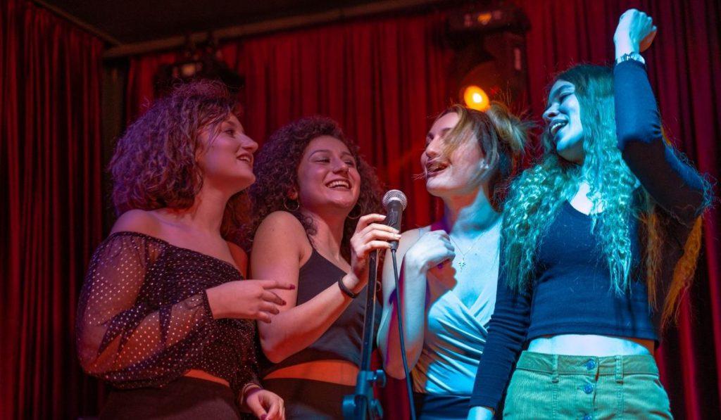 girls having a blast at a karaoke party