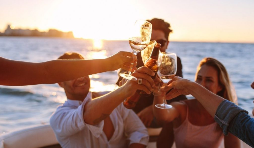 sunset boat party with drinks